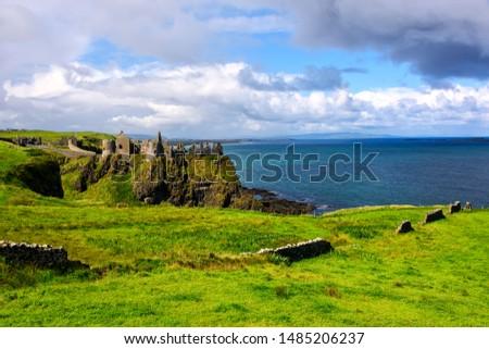 Dunluce Caste, a medieval Irish castle on the Amtrim Coastline #1485206237