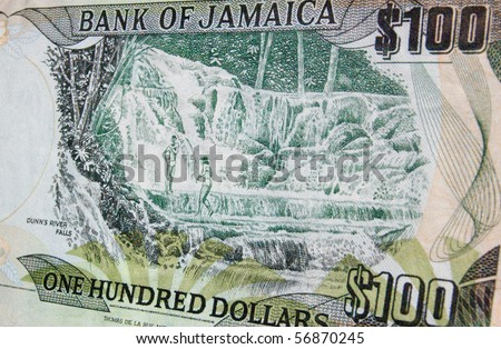Dunn's River Falls Jamaica banknote The reverse of a one hundred dollar banknote from Jamaica showing the country's famous Dunns River Falls where thermal springs form a natural landmark.