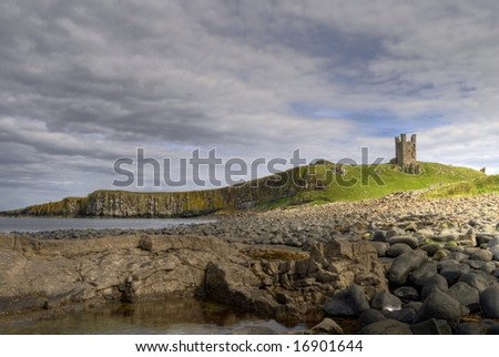 Dunstanburgh Castle, cliffs, and rocky coast in Northumberland, England