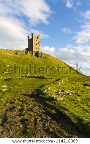 Dunstanburgh Castle lies on a spectacular headland on the coast of Northumberland in northern England, between the villages of Craster and Embleton.