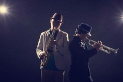 duo musician in dark,saxophone player and trumpet player on vintage tone color