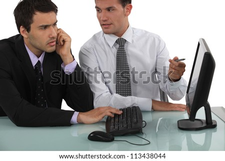 duo of businessmen working with computer