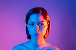 Duo tone lighting portrait of a latina girl.