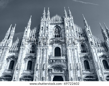 Duomo di Milano, Milan gothic cathedral church - high dynamic range HDR - black and white - stock photo