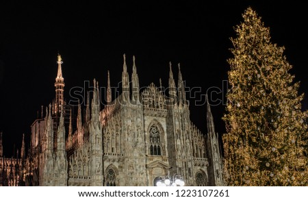 Duomo square lit by a tall Christmas tree in December. Milano, Italy #1223107261