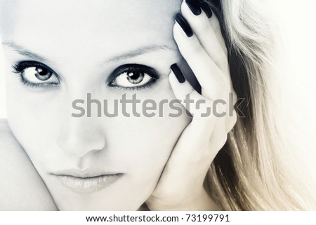 Duotone colored close-up portrait of young girl with beautiful eyes