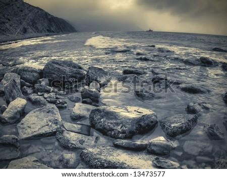 Duotone shot of stones at sea beach - stock photo
