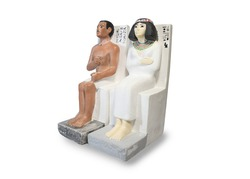 Duplicate souvenir statue of an ancient egyptian man (Ra-hotep) and his wife (Nofret).Travel to Egypt concept.