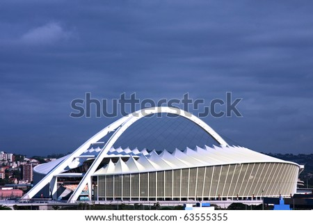 DURBAN, SOUTH AFRICA-CIRCA 2010: New Moses Mabhida soccer stadium custom built for the FIFA Soccer World Cup in Durban, South Africa. It was hosted for the first time circa June 2010 in Africa #63555355
