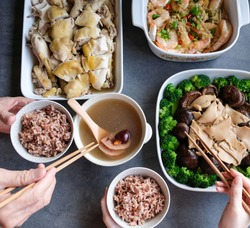 During Chinese festivals, lavish home cooked dishes / Festive Food / Salt baked free range chicken, braised abalone, chinese mushrooms, broccoli, steamed big prawns and double boiled lotus root soup