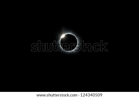 During the 2012 total solar eclipse the moon has completely covered the sun, leaving only a ring of light where the sun has been eclipsed.  A diamond ring appears as the moon slips off the sun.