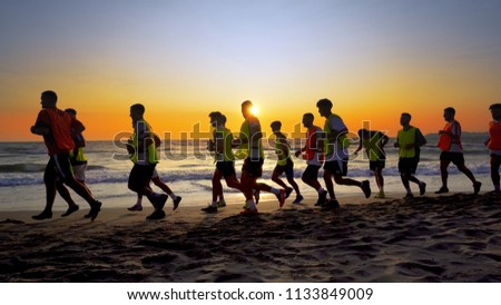 Durres, Albanie - circa Aug, 2017: The soccer team, coaching training running outdoor under the beach sunset, cinematic steadicam shot #1133849009