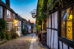 Dusk at a row of beautiful old houses on a cobbled street in Rye, East sussex