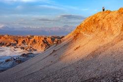 Dusk at El Valle de la Luna (Valley of the Moon) near San Pedro de Atacama in the Cordillera de la Sal region of the Atacama desert in northern Chile, South America. The white areas are salt deposits.