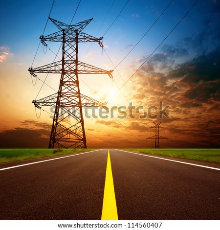Dusk, highways and high-voltage tower.