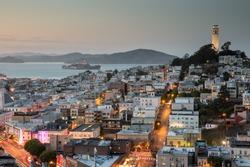 Dusk over Coit Tower, Telegraph Hill and North Beach. San Francisco, California, USA.