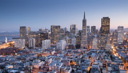 Dusk over San Francisco Downtown as seen from top of Coit Tower in Telegraph Hill.