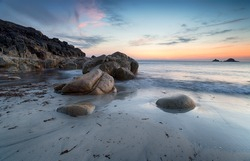 Dusk over the beach at Porth Nanven on the Cornish coast