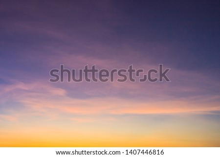 Dusk,Purple Sky in the Evening,Dramatic and Wonderful Cloud on Twilight,Majestic Dark Blue Sky Nature Background,Colorful Cloud on summer season,Idyllic Peaceful Sunlight. #1407446816