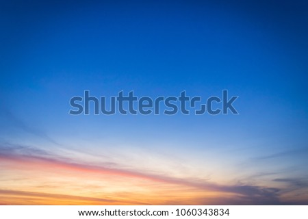 Dusk sky on twilight in the evening,majestic sunset with dramatic sunlight on dark blue sky on summer season,idyllic peaceful nature background.  #1060343834