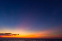 Dusk,Sunset Sky in the Evening,Dramatic and Wonderful Cloud on Twilight,Majestic Dark Blue Sky Nature Background,Colorful Cloud on summer season,Idyllic Peaceful Sunlight.