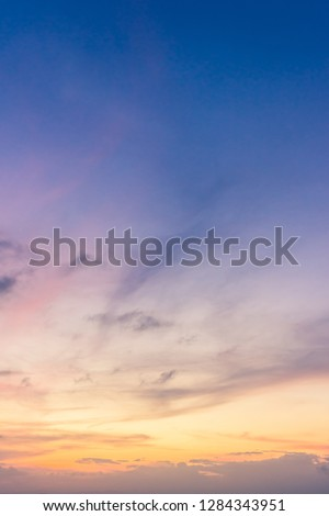 Dusk,Sunset sky twilight in the evening with colorful sunlight and dark blue,majestic ​sky vertical.