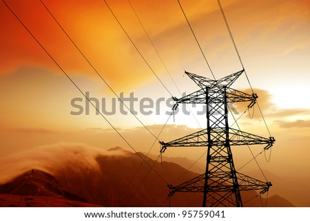 Dusk, the mountains of the high-voltage tower.