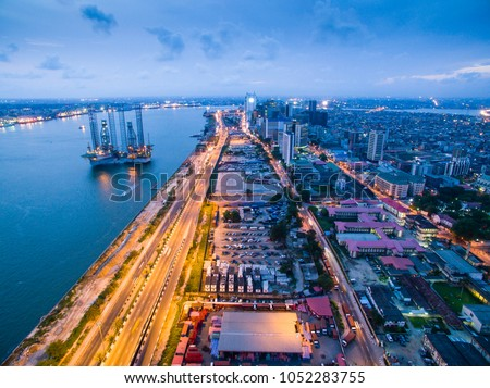 Dusk view of the Lagos Island Central Business District and the marina with the Lagos Harbor in the background