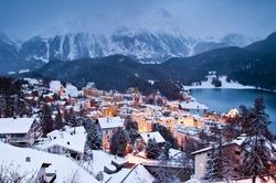 Dusk winter view of the worldwide famous ski resort of St. Moritz, Graubunden, Switzerland