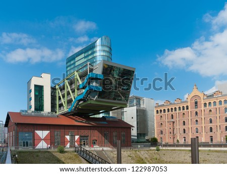 DUSSELDORF - AUGUST 11: Port Event Center on August 11, 2012 in Dusseldorf. It is a complex of a tower as end of the 'mediawalk' and a 35m cantilevered office unit over a highly soundproof event space