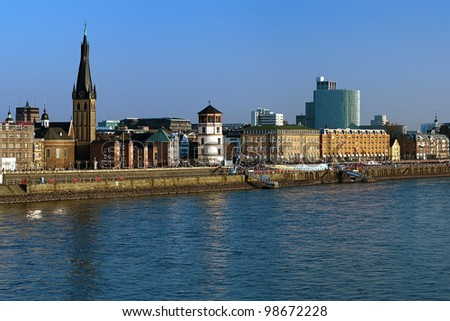 Dusseldorf, Embankment of the Rhine river with Basilica of St. Lambertus and Schlossturm, Germany