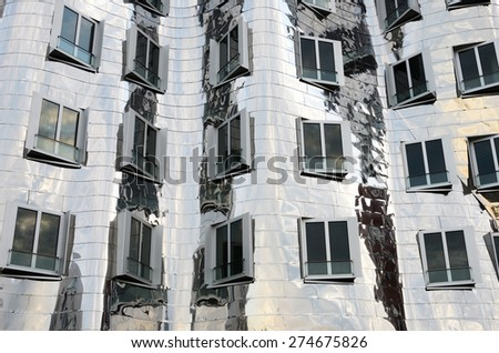 DUSSELDORF, GERMANY - APRIL 29: fragment fasade of the Neuer Zollhof in Media Harbor in Dusseldorf, Germany on APRIL 29, 2015. This building was designed by Frank O. Gehry and completed in 1998.   #274675826
