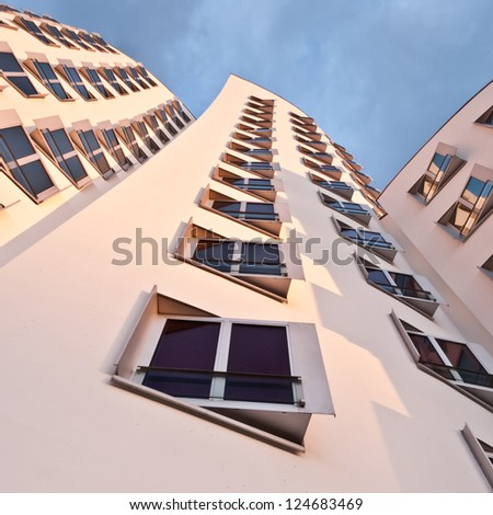 DUSSELDORF, GERMANY - APRIL 27: View of the Neuer Zollhof in Media Harbor in Dusseldorf, Germany April 27 2012. This building complex was designed by Frank O. Gehry and completed in 1998.