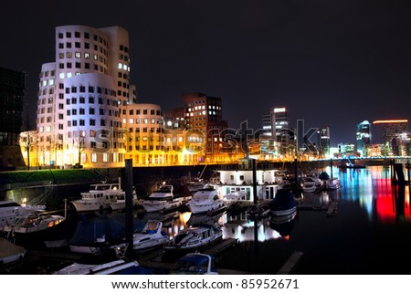 DUSSELDORF, GERMANY - FEB 16: Night view of Dusseldorf harbor on 16 Feb, 2011.The Hafen district itself contains some spectacular post-modern architecture, most famously constructions by Frank Gehry