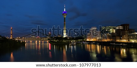 DUSSELDORF, GERMANY - JUNE 22: Evening panorama of the Media Harbor on June 22, 2012 in Dusseldorf, Germany. The Media Harbor is the most popular destination for architectural tourism in the city.