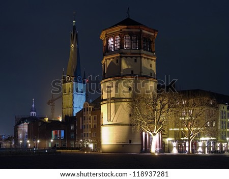DUSSELDORF, GERMANY - MARCH 13: Night view of Schlossturm Tower and Basilica of St Lambertus on March 13, 2012 in Dusseldorf, Germany. This view is the one of the most popular image of Dusseldorf.