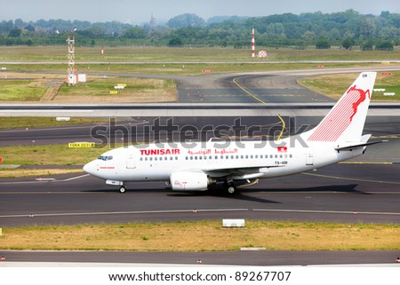 DUSSELDORF, GERMANY - MAY 21: Airplane Boeing 737-6H3 landed in the airport on May, 21 2011 in Dusseldorf. Tunisair flies to destinations across Africa, Asia and Europe. - stock photo