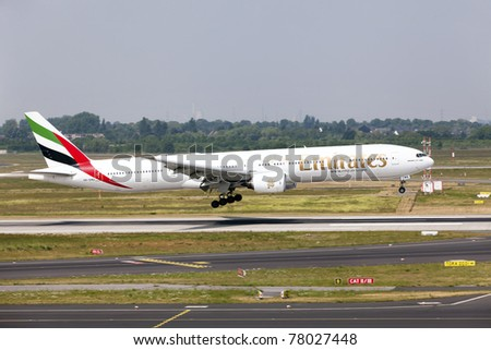 DUSSELDORF, GERMANY - MAY 21: Airplane Boeing 777-300 lands in the airport on May, 21 2011 in Dusseldorf. Emirates became the world's largest operator of the Boeing 777.