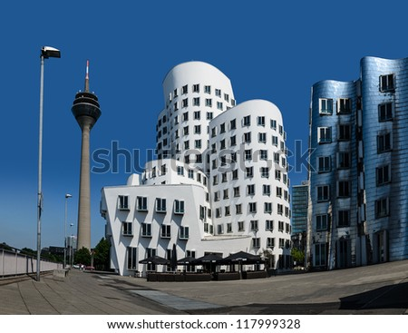 DUSSELDORF, GERMANY - MAY 24: View of the Neuer Zollhof, designed by Canadian architect Frank O. Gehry and completed in 1998, in the Media Harbor in Dusseldorf, Germany on May 24, 2012.