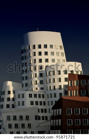 DUSSELDORF, GERMANY - NOVEMBER 19: View of the Neuer Zollhof in Media Harbor in Dusseldorf, Germany November 19, 2011. This building complex was designed by Frank O. Gehry and completed in 1998.
