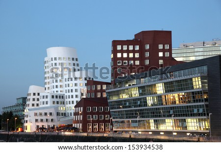 DUSSELDORF, GERMANY - SEPT 4: View of the Neuer Zollhof, designed by the architect Frank O. Gehry and completed in 1998, in the Media Harbor in Dusseldorf, Germany on September 04, 2013 - stock photo