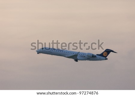 DUSSELDORF, GERMANY - SEPTEMBER, 25: Lufthansa Regional (CityLine) Canadair Regional Jet CRJ701ER  in climb flight over Dusseldorf on September 25, 2011. This jet has a seating capacity of about 70.