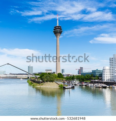 Dusseldorf media harbor with rheinturm at a sunny summer day #532681948