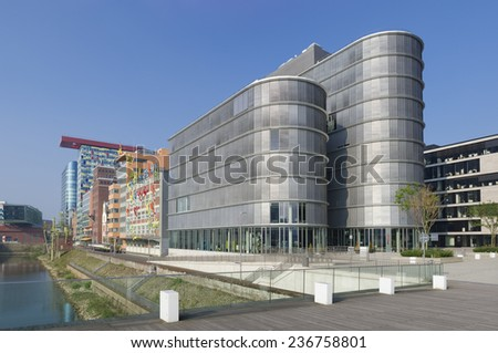 DUSSELDORF - SEPTEMBER 6, 2014: Modern office building in the media harbor.The Hafen district contains some spectacular post-modern architecture, but also some bars, restaurants and pubs. #236758801