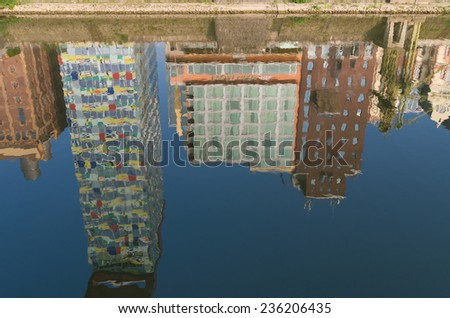 DUSSELDORF - SEPTEMBER 6, 2014: Reflection of office buildings in the media harbor. The Hafen district contains some spectacular post-modern architecture, but also some bars, restaurants and pubs
