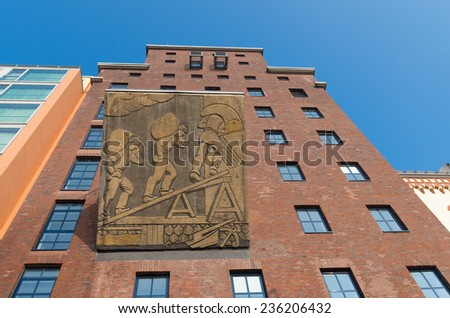 DUSSELDORF - SEPTEMBER 6, 2014: Restored factory building in the media harbor. The Hafen district contains some spectacular post-modern architecture, but also some bars, restaurants and pubs