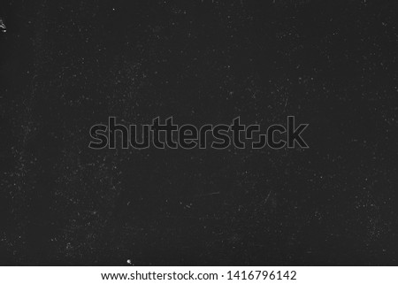 Dust and scratches design. Black abstract background. Stained surface. Copy space.