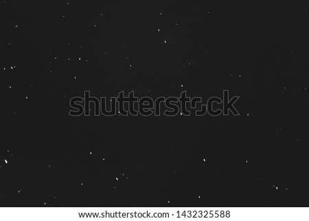 Dust and scratches design. Black abstract background. Star night sky effect. Copy space.