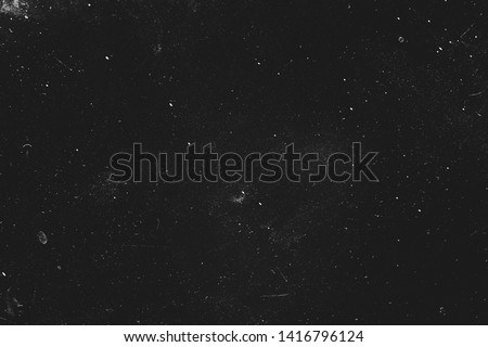 Dust and scratches design. Black abstract background. Vintage effect. Copy space.