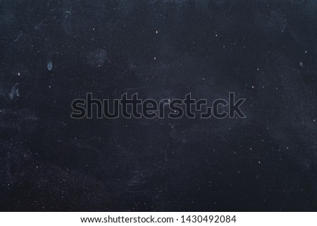 Dust and scratches design. Dark blue grunge abstract background. Distressed surface. Copy space.
